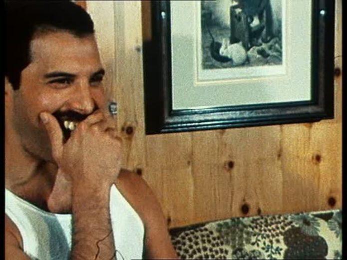 Freddie covers his teeth