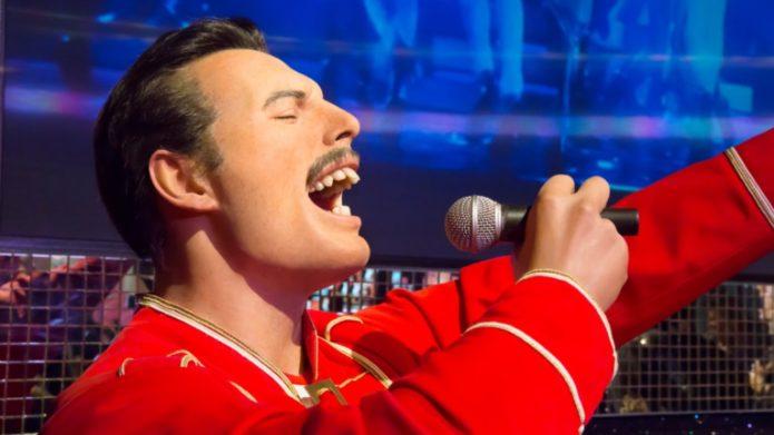 Freddie Mercury in a red robe